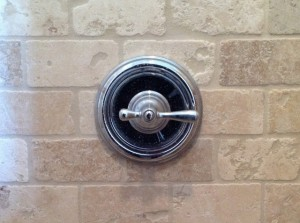 Shower handle turned to right for hot water