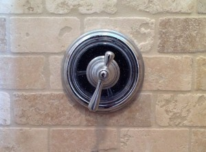 Shower handle turned down for pleasant temperature